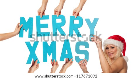 Turquoise blue alphabet lettering spelling MERRY XMAS held up over an isolated white background by outstretched female hands with a sexy beautiful woman in a red Santa hat - stock photo