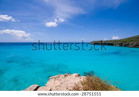 turquoise caribbean bay view  with a nice deserted beach - stock photo