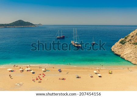 Turquoise Coast with Tourists and Yachts. Cross Processing Style - stock photo