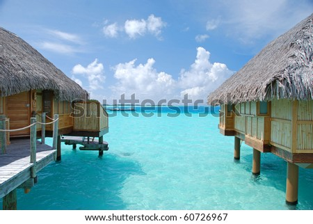 turquoise color lagoon among overwater bungalows - stock photo