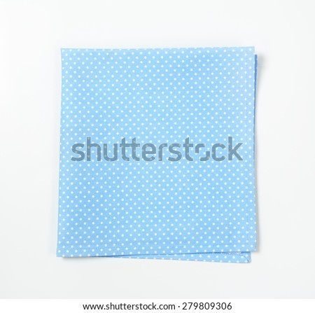 turquoise dotted place mat on white background - stock photo