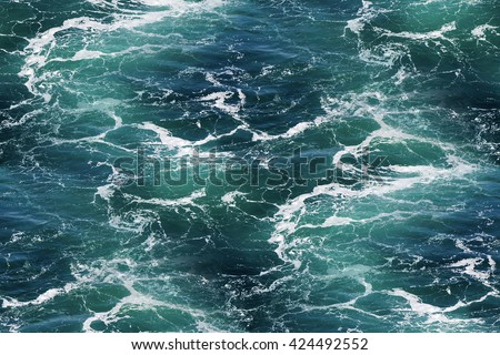 Turquoise green Seawater with sea foam as seamless background - stock photo