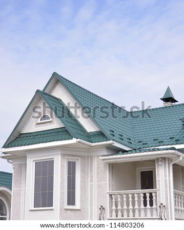 turquoise house roof - stock photo
