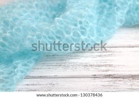 Turquoise knit frame - stock photo
