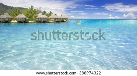 Turquoise lagoons of the tropical island. The beautiful place for restoration of forces, rest, aquatics, suntan and bathing. Warm sea water, white sand, breeze. - stock photo