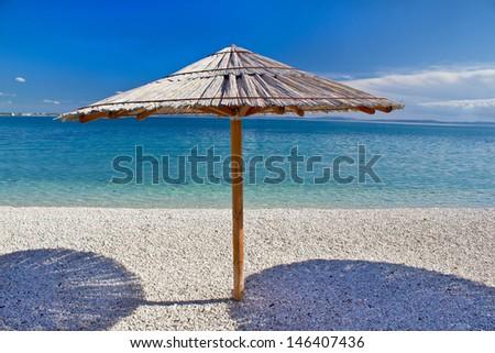 Turquoise pebble beach in Croatia, Dalmatia - stock photo