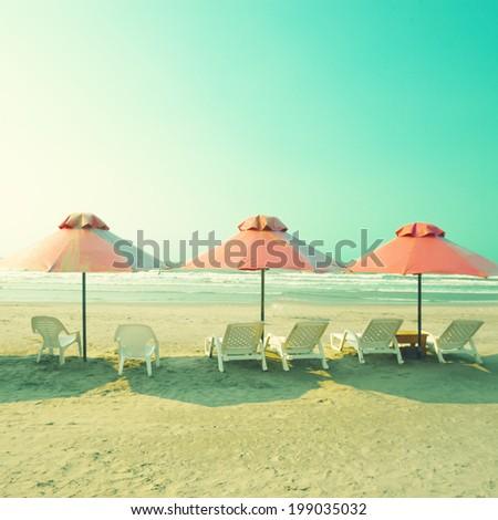 Turquoise retro beach - stock photo