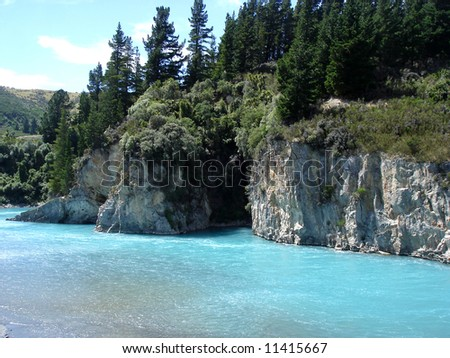Turquoise river - stock photo