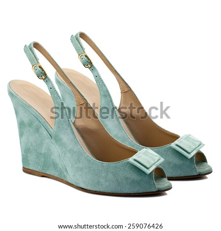 Turquoise suede women shoes isolated on white background. - stock photo