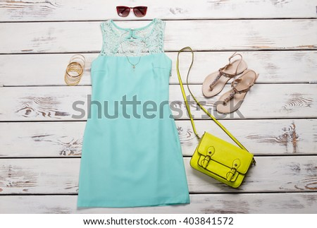 Turquoise summer dress with accessories. Preparation for summer. - stock photo