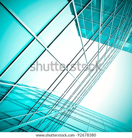 turquoise wall of glass building skyscrapers - stock photo