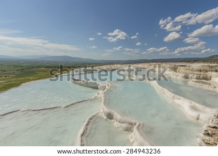 Turquoise  water in the Terraces of Pamukkale - stock photo