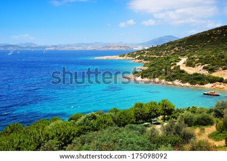 Turquoise water near beach on Turkish resort, Bodrum, Turkey - stock photo