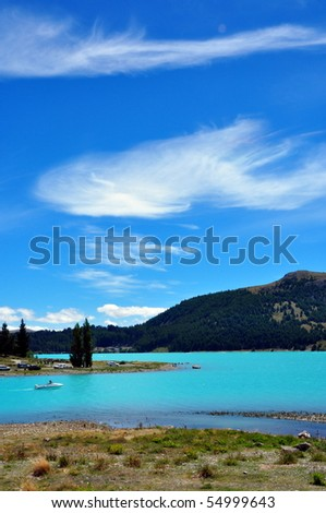 Turquoise water of glacial Lake Tekapo and The Church of Good Shepard , South Island, New Zealand - stock photo
