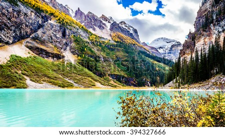 Turquoise water of Lake Louise and Fairview Mountain in Banff National Park in the Canadian Rocky Mountains - stock photo