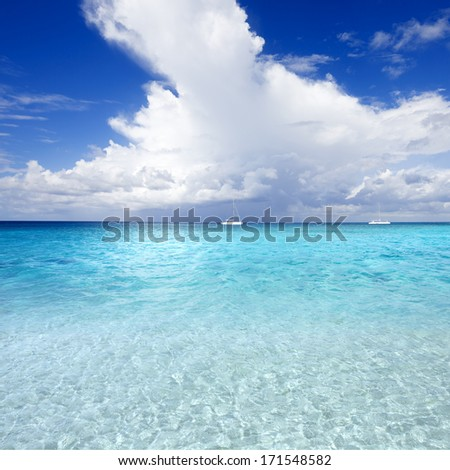 Turquoise water of tropics. Driving by boats and yachts. Excellent windsurfing. - stock photo