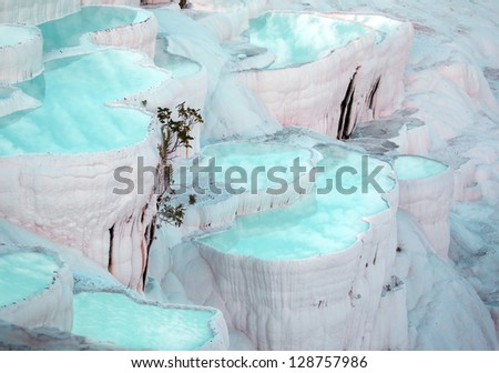 turquoise water travertine pools at pamukkale.  Clouds reflection on the water - stock photo