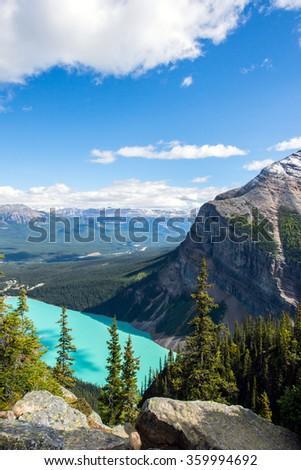 turquoise waters of lake louise seen from the top of a hiking trail in the rocky mountains of alberta canada - stock photo
