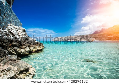 Turquoise waters of mediterranean sea with cliffs. Limeni, Greece. - stock photo