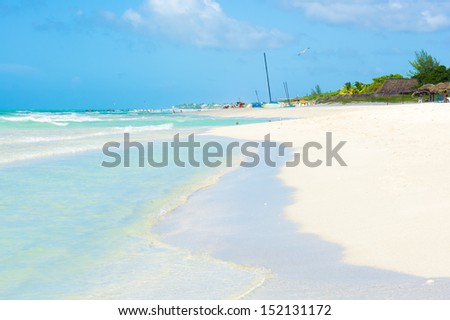 Turquoise waves on the beautiful Varadero beach in Cuba on a summer day - stock photo
