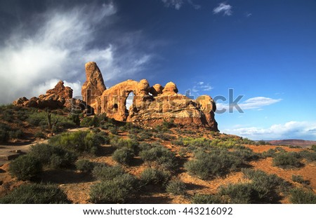 Turret Arch and clouds, Arches National Park Moab Utah - stock photo