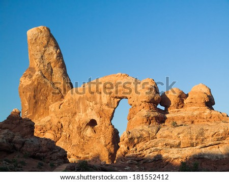 Turret Arch, in Utah's Arches National Park, is seen in early morning light. - stock photo