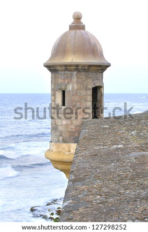 Turret at the corner of the thick wall of the fortress of San Juan overlooking the Atlantic Ocean - stock photo