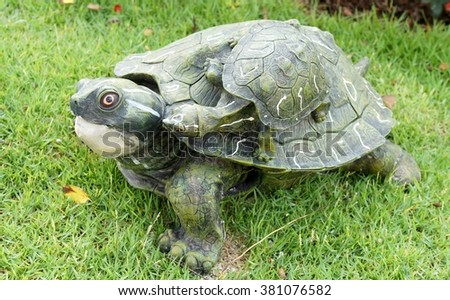 Turtle sculpture for garden decoration - stock photo