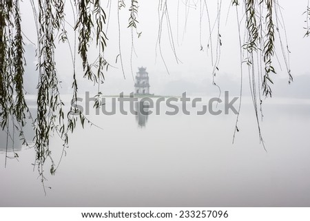 Turtle Tower (HoanKiem Lake - Ha Noi Capital, Vietnam) blur in fog - stock photo
