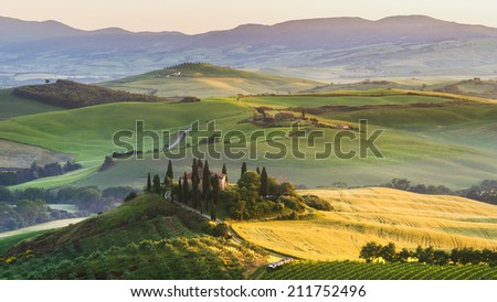 Tuscan landscape at sunrise in silence and colors of peace - stock photo