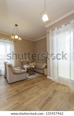 Tuscany - beige sofa in living room - stock photo
