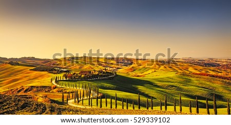 Tuscany countryside panorama, rolling hills and green fields on sunset. Italy, Europe