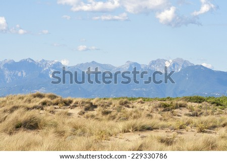 Tuscany deserted landscape with sand dunes and mountains, Italy - stock photo