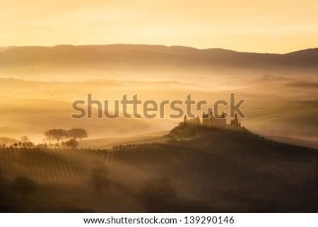 Tuscany hills at sunrise - stock photo