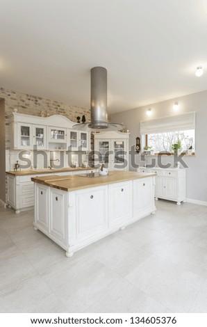 Tuscany - interior of white stylish kitchen - stock photo