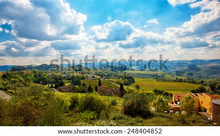 Tuscany, italian rural meadow landscape. With some farms around - stock photo