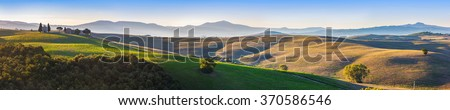 Tuscany landscape panorama at sunrise with a chapel of Madonna di Vitaleta, San Quirico d'Orcia, Italy. - stock photo