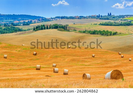Tuscany landscape,typical cityscape and hay bales on the hills,near Val d'Orcia,Italy,Europe - stock photo