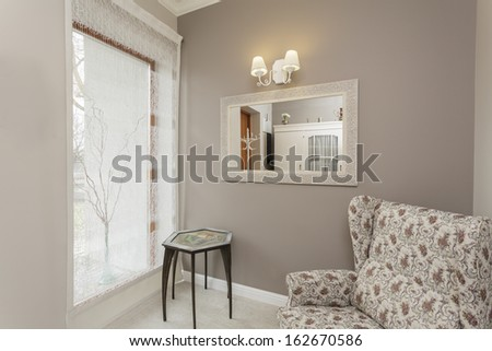 Tuscany - living room with floral armchair - stock photo