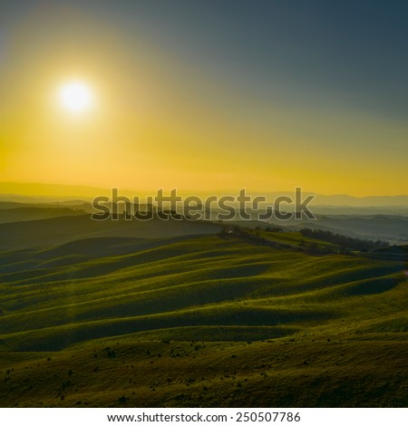 Tuscany, rural landscape in Crete Senesi land. Rolling hills, countryside farm, green field on warm sunset. Siena, Italy, Europe. - stock photo