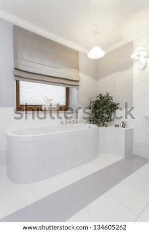 Tuscany - stylish white bath in bathroom - stock photo