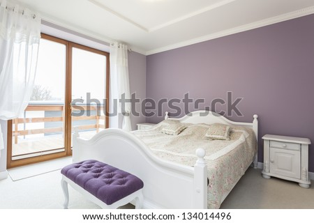 Tuscany - white and purple interior of bedroom - stock photo
