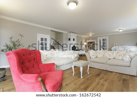 Tuscany - white sofa and red armchair - stock photo