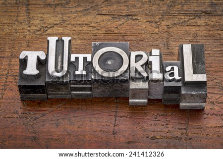 tutorial word in mixed vintage metal type printing blocks over grunge wood - stock photo