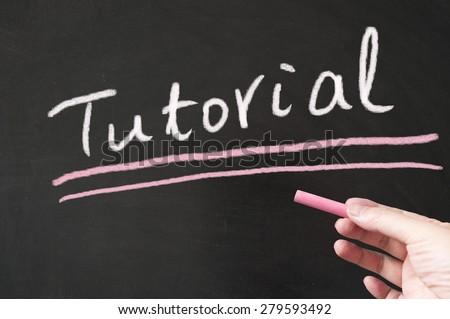 Tutorial word written on the blackboard using chalk - stock photo