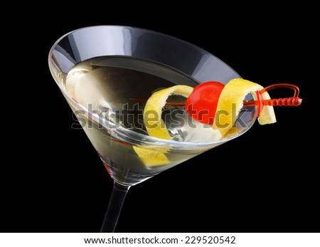 Tuxedo cocktail, consisting of Old Tom Gin, dry vermouth, maraschino liqueur, absinthe and orange bitters, garnished with a maraschino cherry and a lemon twist - stock photo