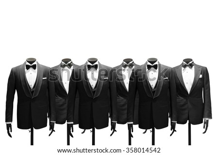Tuxedo stands isolated on background - stock photo