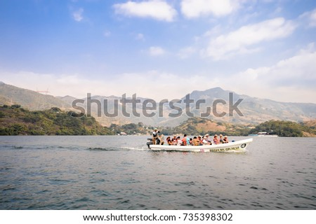 Tuxtla Gutierrez, Mexico - December 20, 2014: Motor boat carries tourists on a ride through the Canyons del Sumidero in Chiapas near Tuxtla Gutierrez, Mexico