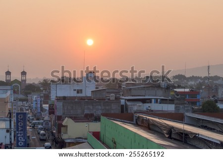 TUXTLA GUTIERREZ, MEXICO - FEBRUARY 11, 2014: The early morning sun glows over the marketplace and downtown area of Tuxtla Gutierrez in Chiapas, Mexico - stock photo