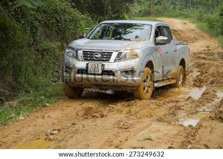 Tuyen Quang, Viet Nam - April 23, 2015: Nissan NP300 Navara car running on the mud road in Vietnam